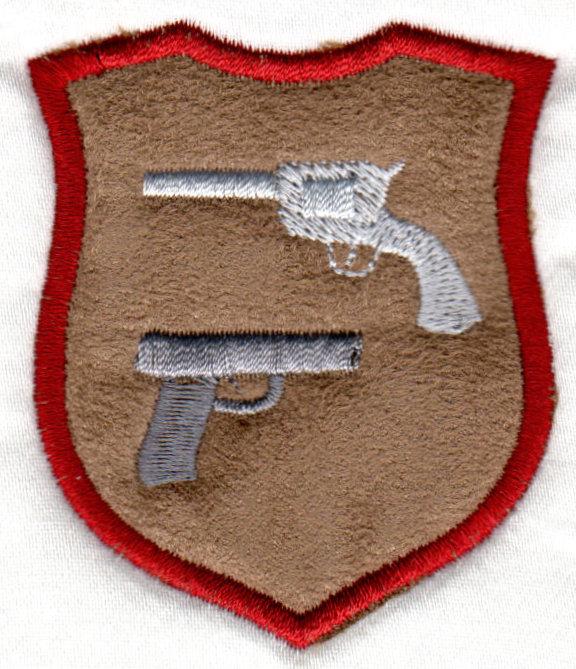 Applique crest with guns a gun embroidery design